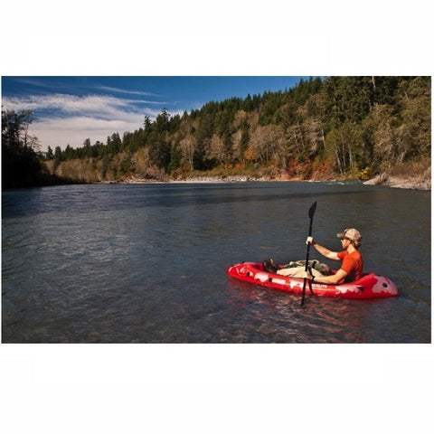 Paddling a red Advanced Elements PackLite 1 Person Inflatable Kayak out on the river.