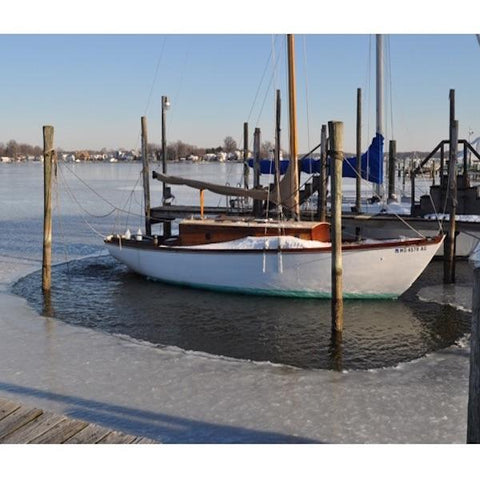 A PowerHouse Ice Eater for Sale is protecting a sailboat in a dock from ice damage.  Multiple PowerHouse Ice Eater Dock DeIcers can be used together with other Power House Ice Eaters for Sale to build a dock buller system from several dock deicers.  Full dock ice protection will ensure the safety of your investments.
