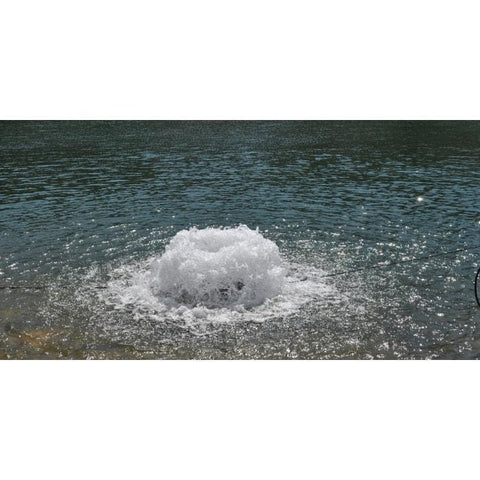 F1000DP Surface Aerator in the water creating a boiling affect.