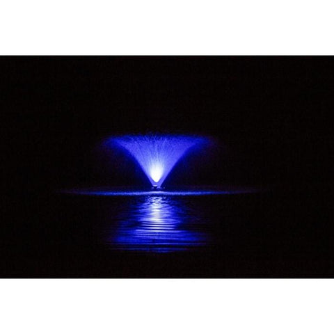 Power House F1000F 115v-230v 1 Hp Aerating Fountain being lit up by a blue Light Kit on a pitch black night, reflection can be seen off the water.