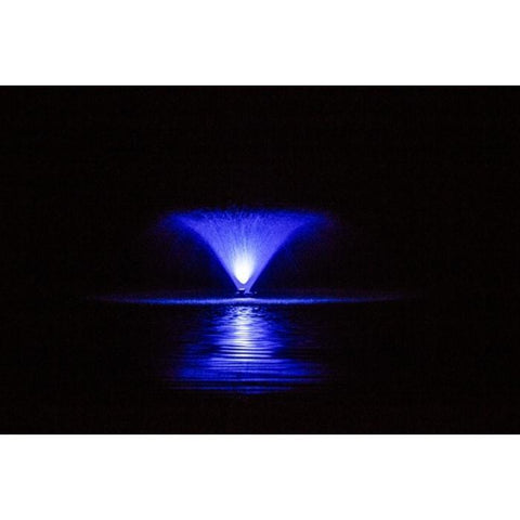 Aerating Fountain with Color Changing LED Lights on a lake at night with the spray lit up in blue.