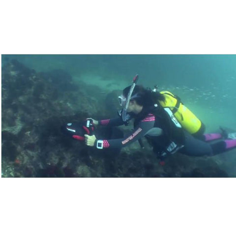 Woman using a Yamaha RDS 300 Seascooter to propel her across the ocean floor exploring a reef.