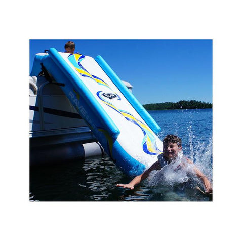 A boy splashes into the lake after a slide down the rave inflatable pontoon boat slide.