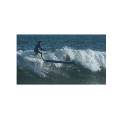 Sea Eagle Longboard 126 Inflatable SUP riding a wave.