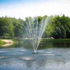 Scott Aerator Belcrest Pond Fountain sprays 30 feet high to showcase the beautiful floating fountain on the lake.  Dark Blue waters, light blue skies, and green trees all around.  Beautiful floating water fountains.
