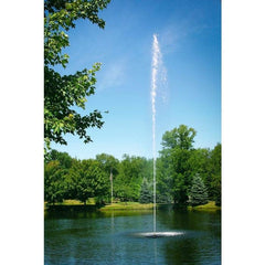 Scott Aerator Jet Stream Pond Fountain 1 1/2 Hp Floating Fountain shows off its astonishing 50 feet columnar spray.  The Jet Stream Floating Fountains are some are the most popular floating fountains on the market.  Shown here as a pond water fountain in a park setting.  Trees around a lake with open green grassy areas also.