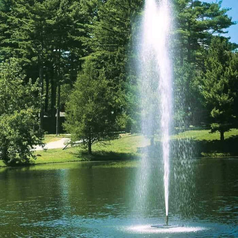 Scott Aerator Gusher Pond Fountain 1 1/2 Hp Floating Fountain sprays a wind resistant column of water 30ft in the air.  Shown here as a floating pond fountain in a park setting with evergreen trees around.