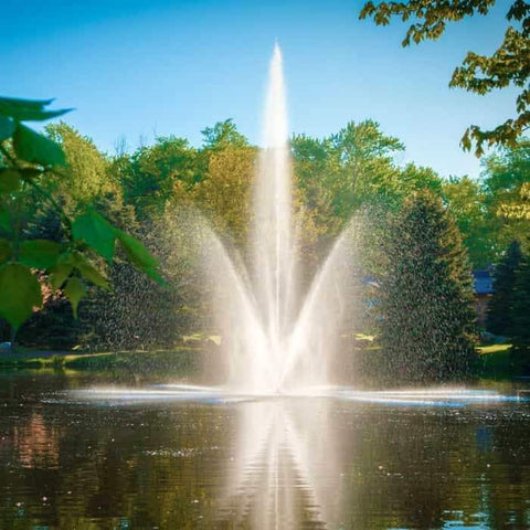 Scott Aerator Atriarch Pond Fountain beautifully sprays water into the air against a background of trees.  The Scott Aerator floating pond fountain, that can also be a lake fountain, sit in the middle of the pond. This beautiful floating water fountain is a glorious sight.