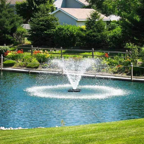 Also known as a Floating Pond Aerator Fountain, the Scott Aerator DA-20 Display Aerator 1 Hp floating pond fountain in the backyard by the garden.