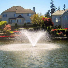 Scott Aerator DA-20 Display Aerator 3 Hp Floating Pond Fountain is a large pond aerator shown in a neighborhood pond.  Beautiful landscaping in the background while the Scott Aerator Surface Aerator beautifully sprays a trumpet shaped spray.