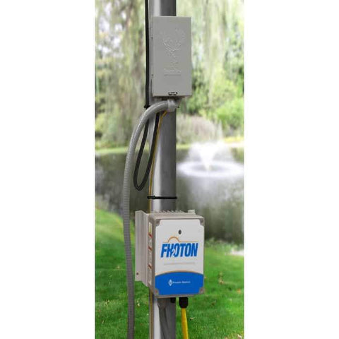 Scott Aerator Boilermaker Floating Solar Pond Aerator 3/4 Hp Surface Aerator solar powered pond fountain control panel on a pole near the pond with the floating solar pond aerator fountain in the background.