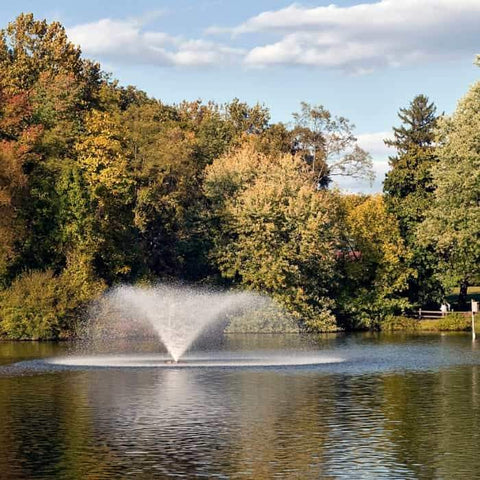 Scott Aerator DA-20 Display Aerator is a 2 Hp floating pond fountain aerator. This large pond aerator is also known as a Floating Pond Aerator Fountain.  In this image the trees are just beginning to fade into fall colors.