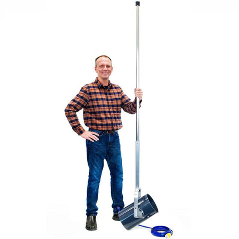Man holding the Scott Aerator Dock Mount De-Icer.  The De-Icer is taller than the man with the extended pole.