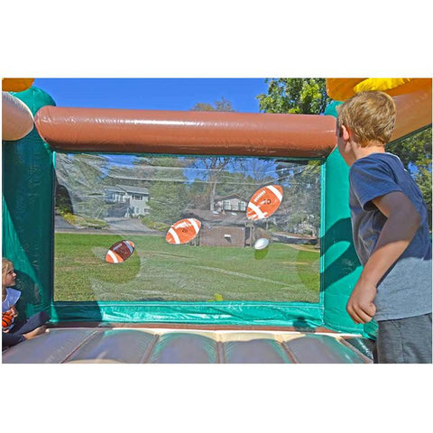Island Hopper Sports N Hops Commercial Jump House Football Throw Game. There are 2 young kids throwing the ball at 3 different footballs on the transparent bounce house wall.