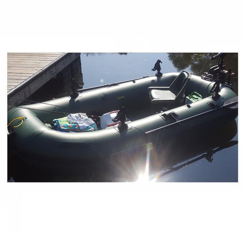 Hunter Green Sea Eagle Stealth Stalker 10 Inflatable Frameless Fishing Boat in the water with one seat with cooler, fishing poles, and gear; plenty of room.