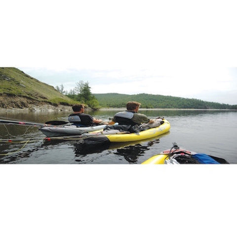 Man floating down the river in a yellow and grey Advanced Elements StraitEdge 1 Person Inflatable Kayak