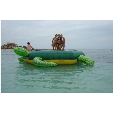 3 girls standing on an Island Hopper Turtle Jump Water Trampoline on the ocean.