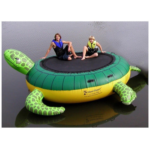 Island Hopper Turtle Hop Water Bouncer - Inflatable Water Bouncer on the water with a mom and young boy.