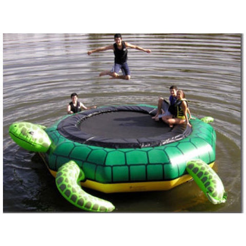3 kids playing on an Island Hopper Turtle Jump Water Trampoline on the lake.