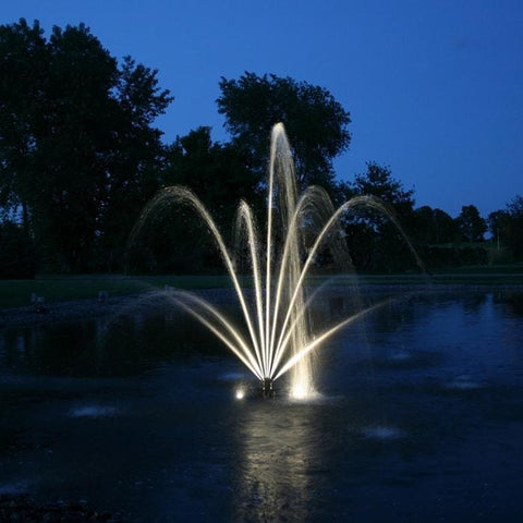 Kasco LED Puck Fountain Light Kit is shown in action, lighting up a fountain on the pond.