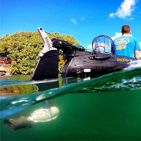 Read underwater view of the grey and black Bixpy Jet Thruster in use behind a kayak using he Bixpy DIY Adapter.  The Bixpy Kayak Jet Motor is fully in place and underwater.  The kayak outboard motor power pack is not visible here.