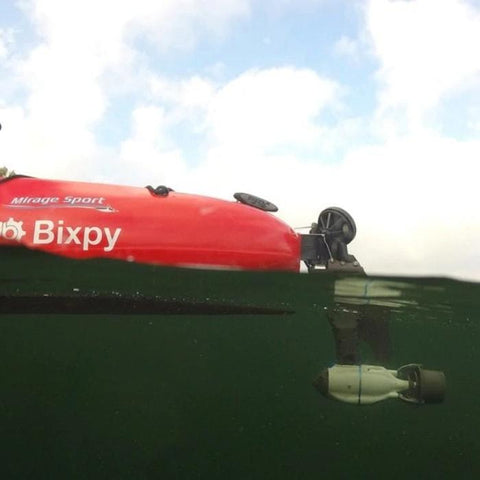 Bixpy Jet Outboard Kayak Motor for sale is shown in an underwater side view.  The Bixpy Jet Thruster is attached to the Bixpy Hobie Twist and Stow Rudder Adapter, the Bixpy 333Wh Outboard Power Pack is not visible.