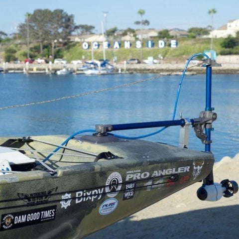 Bixpy Kayak Jet Motor for sale is shown hooked up to a kayak with the Bixpy Hobie Pro Angler Adapter.  The Outboard Kayak Motor Power Pack sits in the rear of the kayak and via a blue cable is connected to the Bixpy Jet Thruster.  Here the kayak jet motor is shown on a kayak that is out of the water apparently on a trailer.  The Bixpy Jet Kayak Motor is shown as an Outboard Kayak Motor for sale in the operating position, but out the water.