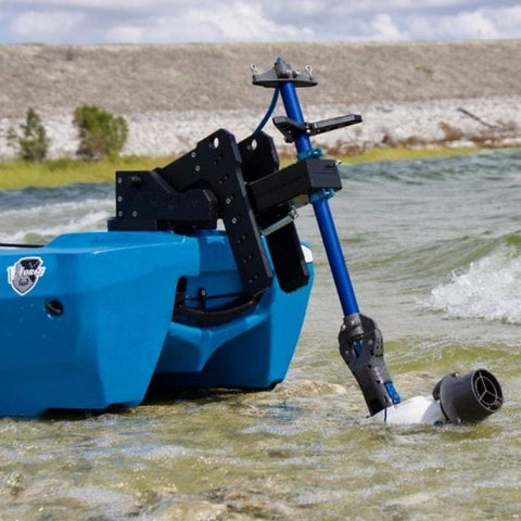Bixpy Kayak Jet Motor Outboard Kayak Motor Kit is shown on the rear of a blue kayak using an Bixpy adapter.  The Bixpy Jet thruster is half in the water and half out, the water is very shallow, only several inches deep.