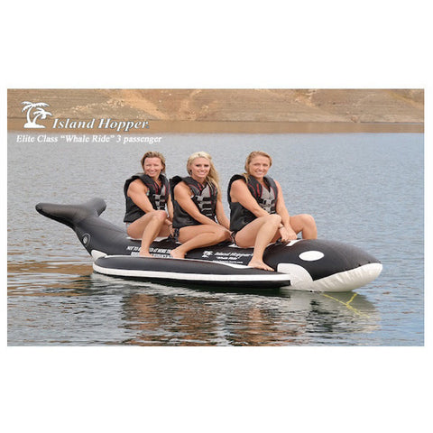 Side view of 3 girls riding the Island Hopper 3 Person Whale Ride Banana Boat Tube