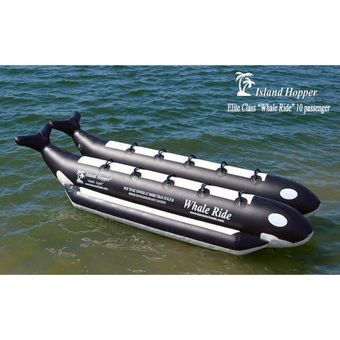 Above top, front side view of the Island Hopper 10 Person Banana Boat Tube Whale Ride sitting on the water.  Features side by side seating for 10 people on 2 inflatable pontoons that are made to look like a killer whale.  Black and white design, color picture.