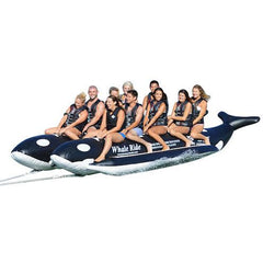 Island Hopper 10 Person Banana Boat Tube Whale Ride front side view.  Full of 10 passengers on the black and white Whale Ride Banana Boat that has each of the 2 side by side inflatable tubes made to look like a killer whale.