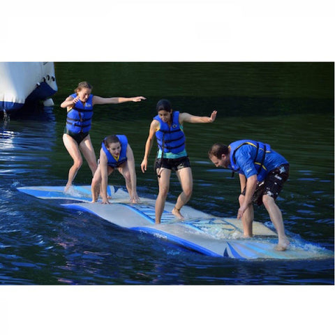 4 people standing on a Rave Water Whoosh 20ft Inflatable Water Mat on a lake. The Rave floating water mats now white with yellow and blue highlights, whereas this is blue and grey, the old swim mat design.