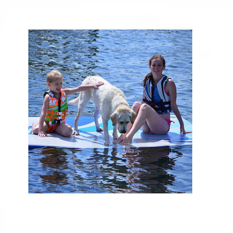 2 girls and a dog on a Rave Water Whoosh 20' Inflatable Water Mat on the lake.