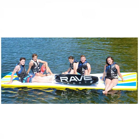 5 kids sitting on a white Rave Water Whoosh 15 Inflatable Water Mat with yellow trim, waiting to wakeboard on the lake. The Rave floating water mat is very buoyant and has no problem floating above the water with 5 kids on it.  Excellent swim mat.