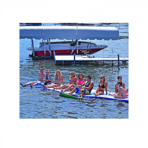 10 young adults sitting on a Rave Water Whoosh 20ft Inflatable Water Mat on a lake.  Waiting to be pulled to wakeboard.