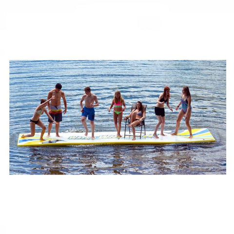 7 young people standing on a white Rave Water Whoosh 20 Inflatable Water Mat on a lake. Rave floating water mats are extremely buoyant as shown here.