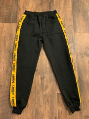 Black sweatpants with gold stripe