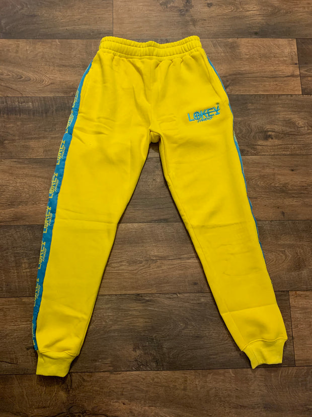 Yellow sweatpants with teal stripe