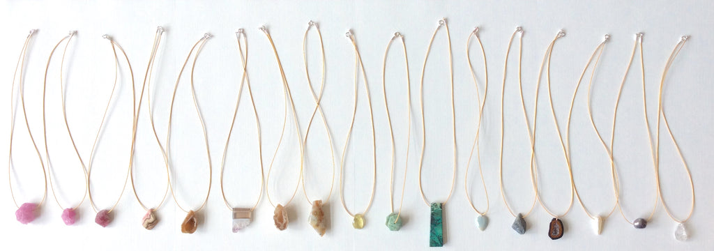Assorted natural faceted & rough gemstones on gold-tone Japanese nylon cord with .925 silver clasp