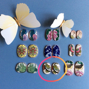 Nephrite jade studs with circled porcelain jackets