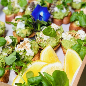 Avocado smash mini toasts with Meredith goats cheese & dukkah (box of 12) - Rosalie Gourmet Market