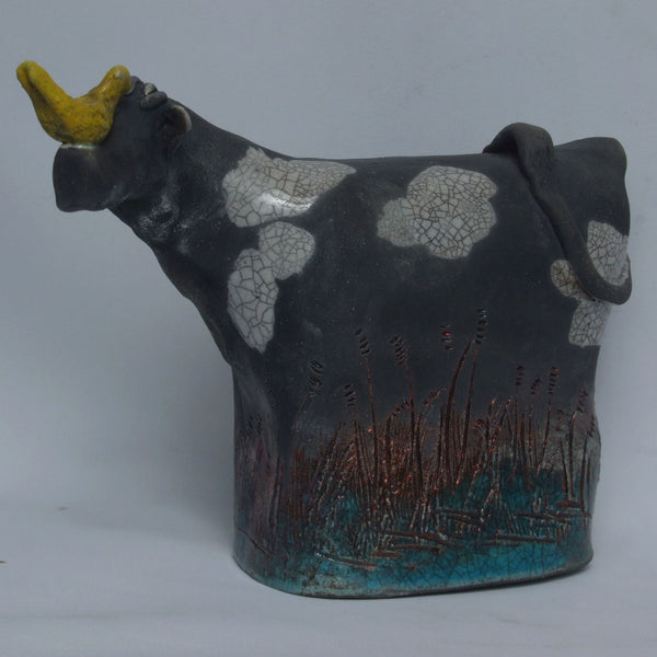 Raku Cow with Yellow Bird
