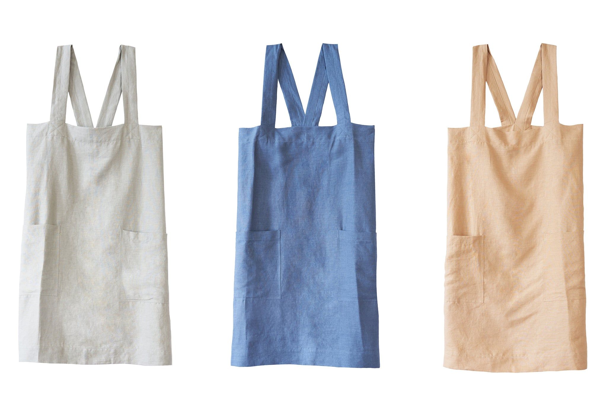 three aprons in sand color, indigo color, camel color