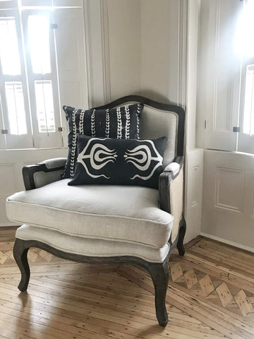 white chair with two black pillows