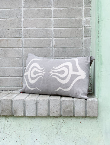 tulips pillow sitting on a wall outside