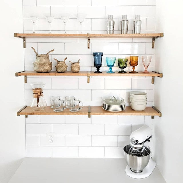 kitchen counter, wall shelfs with glassware and baskets