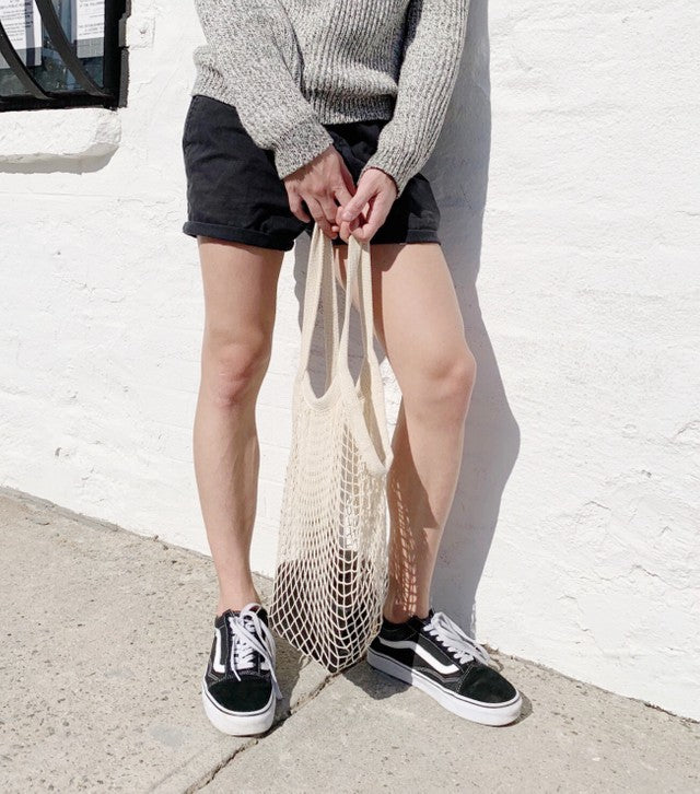 legs and vans with cream net bag