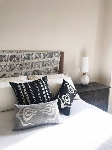 bed with accent pillows on top