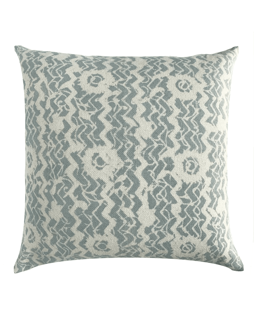 teal and cream patterned pillow