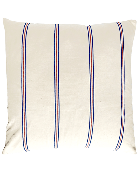 cream with blue and red stripe pillow